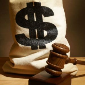a sack of money with a gavel